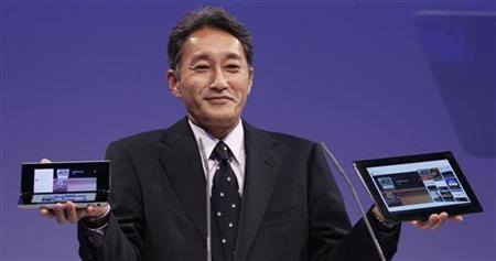 Kazuo Hirai, President and Group CEO of Sony Computer Entertainment, presents the new Sony S tablet (R) and the P tablet during a news conference at the IFA consumer electronics fair in Berlin August 31, 2011.    REUTERS/Tobias Schwarz