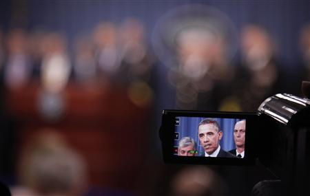 U.S. President Barack Obama is pictured on a video camera screen as he delivers remarks on the strategic defense review at the Pentagon near Washington, January 5, 2012.  REUTERS/Jason Reed