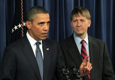 President Barack Obama speaks as Richard Cordray, his appointed head of the Consumer Financial Protection Bureau, stands at his side during Obama's visit to the CFPB in Washington January 6, 2012.  REUTERS/Kevin Lamarque