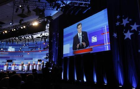 Republican presidential candidate, former Massachusetts Governor Mitt Romney, is displayed on a large screen as she speaks during the Republican Party presidential candidates debate in Sioux City, Iowa, December 15, 2011. REUTERS/Jim Young