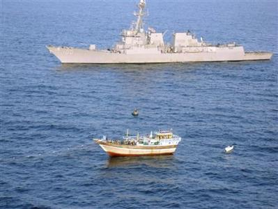 The guided-missile destroyer USS Kidd (DDG 100) responds to a distress call from the master of the Iranian-flagged fishing dhow Al Molai, who claimed he was being held captive by pirates in the Arabian Sea, in this handout photo taken January 5, 2012. REUTERS/U.S. Navy photo/Handout