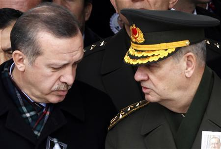 Turkey's Prime Minister Recep Tayyip Erdogan (L) speaks with Chief of Staff General Ilker Basbug during a funeral in Ankara in this February 28, 2010 file photo. REUTERS/Umit Bektas/Files