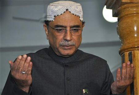 Pakistan's President Asif Ali Zardari, widower of assassinated former Prime Minister Benazir Bhutto, raises his hands in prayer at her grave to mark her death anniversary at the Bhutto family mausoleum in Garhi Khuda Bakhsh, near Larkana December 26, 2011. REUTERS/Nadeem Soomro