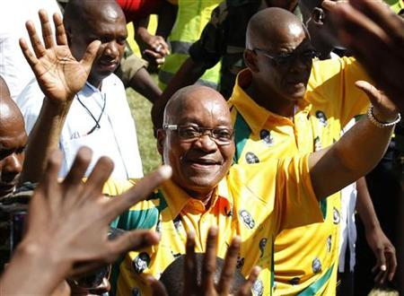 South Africa's president Jacob Zuma greets his supporters during the African National Congress' (ANC) centenary celebration in Bloemfontein January 8, 2012. REUTERS/Siphiwe Sibeko