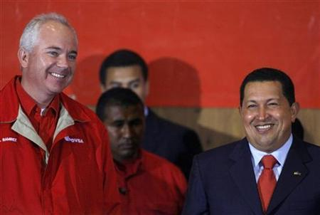 Venezuelan President Hugo Chavez (R) and Oil Minister Rafael Ramirez (L) attend an event to celebrate victory over Exxon Mobil in Caracas March 24, 2008. REUTERS/Jorge Silva