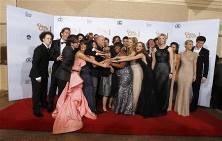 Ryan Murphy (front row 4th L), creator of the TV series 'Glee', and cast members pose with the award for best television comedy series at the 68th annual Golden Globe Awards in Beverly Hills, California, January 16, 2011.  REUTERS/Lucy Nicholson