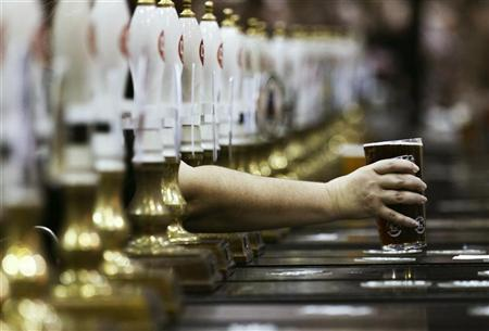 A pint of beer is served through rows of beer pumps at the Campaign For Real Ale Great British Beer Festival at Earls Court in London August 2, 2011.  REUTERS/Luke MacGregor