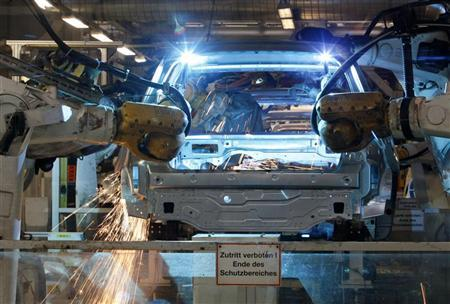Welding robots assemble a bodywork of a Volkswagen's Golf VI car in a production line at the Volkswagen headquarters in Wolfsburg March 8, 2010.    REUTERS/Fabrizio Bensch