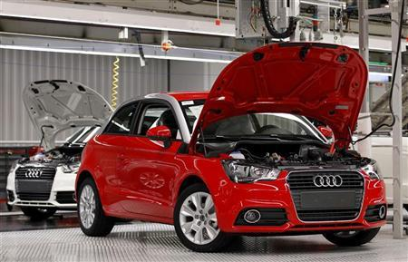 Newly assembled Audi A1 cars are seen during a visit by Belgium's King Albert II (not pictured) celebrating the 100,000th Audi A1 car assembled and the first anniversary of its production at the Brussels' assembly plant June 23, 2011.  REUTERS/Francois Lenoir
