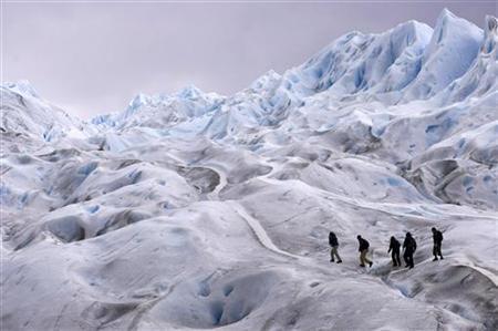 Climbers trek on Argentina's Perito Moreno glacier near the city of El Calafate, in the Patagonian province of Santa Cruz, December 16, 2009. REUTERS/Marcos Brindicci