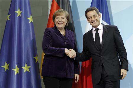 French President Nicolas Sarkozy and German Chancellor Angela Merkel shake hands after a news conference following their talks at the Chancellery in Berlin January 9, 2012.  REUTERS/Fabrizio Bensch