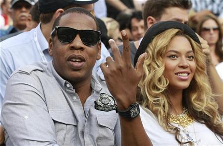 Rapper Jay-Z and his wife, singer Beyonce, attend the match between Novak Djokovic of Serbia and Rafael Nadal of Spain in the men's final of the U.S. Open tennis tournament in New York, September 12, 2011.      REUTERS/Lucy Nicholson