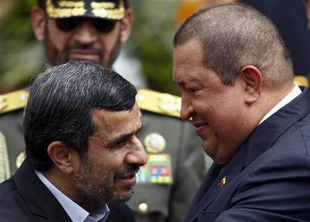 Iran's President Mahmoud Ahmadinejad (L) is welcomed by Venezuela's President Hugo Chavez at Miraflores Palace in Caracas January 9, 2012. REUTERS/Carlos Garcia Rawlins