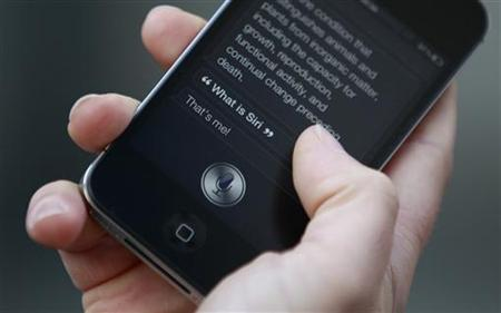 Luke Peters demonstrates Siri, an application which uses voice recognition and detection on the iPhone 4S, outside the Apple store in Covent Garden, London  October 14, 2011. REUTERS/Suzanne Plunkett