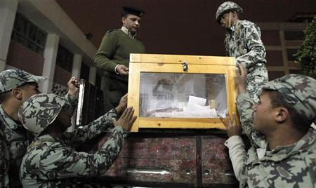 Army soldiers transport a ballot box to a counting centre after voting closed at a polling station during the last day of parliamentary elections at Shubra in El-Kalubia, on the outskirts of Cairo, January 4, 2012. REUTERS/Mohamed Abd El-Ghany