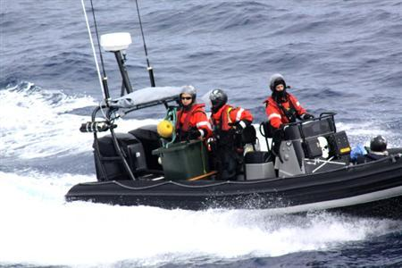 Activists from the Sea Shepherd Conservation Society aboard a rubber boat approach Japanese Research vessel Yushin Maru No. 3 in the Antarctic, in this handout photo taken on January 6, 2012, released by the Institute of Cetacean Research (ICR) to Reuters on January 7, 2012. REUTERS/The Institute of Cetacean Research/Handout