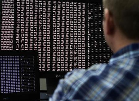 An analyst looks at code in the malware lab of a cyber security defense lab at the Idaho National Laboratory in Idaho Falls, Idaho September 29, 2011. REUTERS/Jim Urquhart/Files