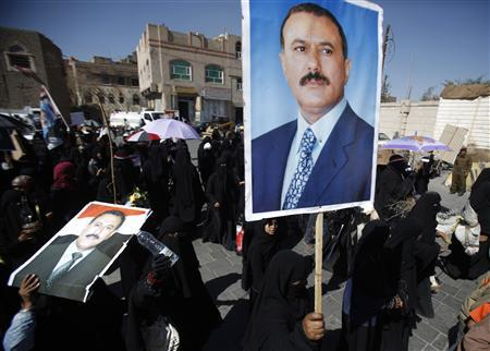 Female supporters of Yemen's outgoing President Ali Abdullah Saleh (pictured in posters) march during a demonstration to demand better living conditions from the new opposition-led government in Sanaa January 9, 2012. REUTERS/Khaled Abdullah
