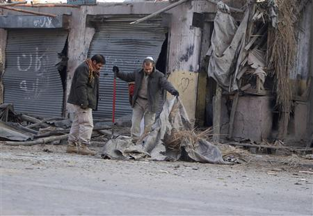 Afghans inspect the site of an explosion in Jalalabad province January 10, 2012. At least six people were wounded including two policemen as result of an explosion, the Interior Ministry said in a statement. REUTERS/Parwiz