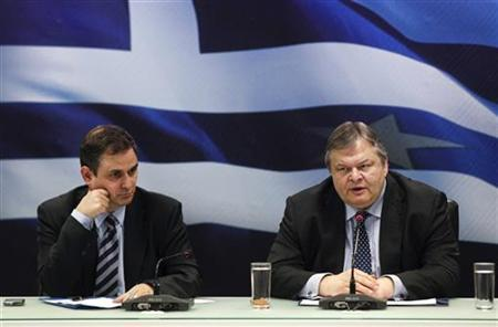 Greece's Finance Minister Evangelos Venizelos (R) addresses reporters while Deputy Finance minister Filippos Sachinidis looks on during a news conference in Athens, December 12, 2011. REUTERS/Yiorgos Karahalis
