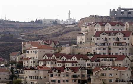 A mosque in the Palestinian West Bank village of Abdullah Ibrahim (rear) is seen behind houses in West Bank Jewish settlement of Efrat, near Bethlehem December 22, 2011. REUTERS/Baz Ratner