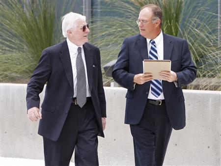 Donald McGhan (L) talks with attorney Mark Dzarnoski as they walk towards the Lloyd D. George U.S. Federal Courthouse in Las Vegas, Nevada in this June 8, 2009 handout released to Reuters January 9, 2012.  REUTERS-Las Vegas Review-Journal-Duane Prokop