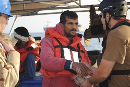 1 of 3. An Iranian mariner greets a U.S. Coast Guardsman from the U.S. Coast Guard Cutter Monomoy which offered assistance to six Iranian mariners in the Arabian Gulf in this January 10, 2012 handout.  Credit: REUTERS/U.S. Coast Guard Photo/Handou