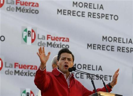 Enrique Pena Nieto, presidential candidate for the opposition Institutional Revolutionary Party (PRI), addresses the crowd during an appearance to support his party's candidate for mayor after their electoral win was annulled in Morelia January 2, 2012.  REUTERS/Leovigildo Gonzalez