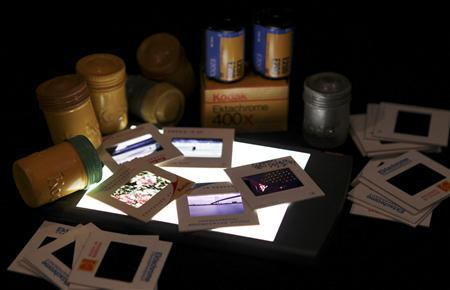 A collection of Eastman Kodak color slide film and 35mm film containers is shown January 6, 2012 in this studio illustration in Washington. Eastman Kodak Co announced a new business structure on January 10, 2012, that eliminates its film group as the once-iconic photography company tries to refocus as a digital company to help fend off financial difficulties. Picture taken January 6, 2012.       REUTERS/Gary Cameron