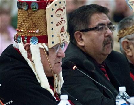 Hereditary Chief of the Haisla First Nation, Sam Robinson (L), testifies next to Henry Amos, a band councillor, before the Enbridge's Inc's Northern Gateway pipeline Joint Review hearing in Kitamaat Village, British Columbia, January 10, 2012. Aboriginal leaders opposed to a C$5.5 billion ($5.4 billion) oil sands pipeline backed by Canada's government warned on Tuesday that the project could devastate fishing and traditional life on the rugged Pacific Coast and called for it to be stopped. REUTERS/Robin Rowland