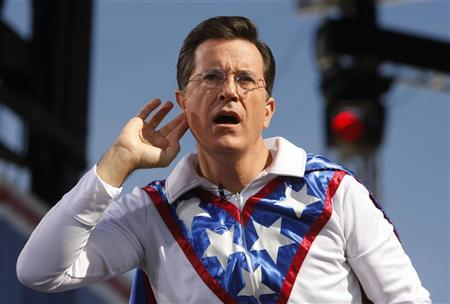 Comedian Stephen Colbert gestures during the ''Rally to Restore Sanity and/or Fear'' on the National Mall in Washington, October 30, 2010. REUTERS/Jim Bourg