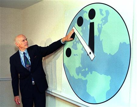 Leonard Reiser, chairman of the Bulletin of the Atomic Scientists and member of the Manhattan Project adjusts the Doomsday Clock. REUTERS