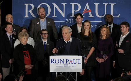 Republican presidential candidate U.S. Congressman Ron Paul addresses his New Hampshire primary night rally, as his wife Carol (L) looks on in Manchester, New Hampshire, January 10, 2012.  REUTERS/Neal Hamberg