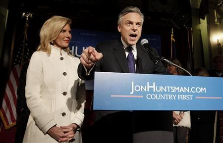Republican presidential candidate former Utah Governor Jon Huntsman addresses supporters with his wife Mary Kaye at his New Hampshire primary night rally in Manchester, New Hampshire, January 10, 2012. REUTERS/Adam Hunger
