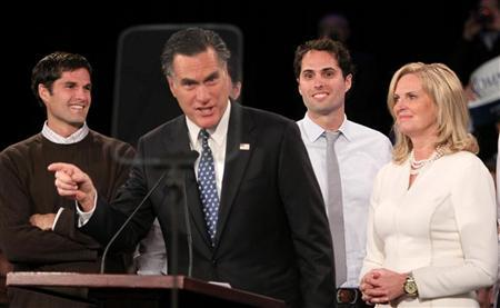 Republican presidential candidate and former Massachusetts Governor Mitt Romney addresses supporters as his wife Ann and their sons look on at his New Hampshire primary night rally in Manchester, New Hampshire, January 10, 2012. REUTERS/Larry Rubenstein