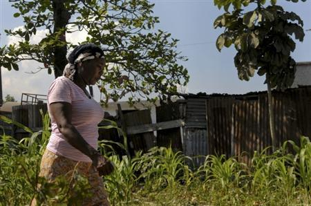 Lucienne Bounba walks through the parcel of land where her house once stood before the January 2010 earthquake, in Carrefour an area outside of Port-au-Prince January 10, 2012. REUTERS/Swoan Parker