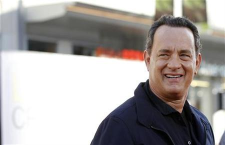 Director and cast member Tom Hanks poses at the world premiere of ''Larry Crowne'' at the Chinese theatre in Hollywood, California June 27, 2011. The movie opens in the U.S. on July 1. REUTERS/Mario Anzuoni  (UNITED STATES - Tags: ENTERTAINMENT)