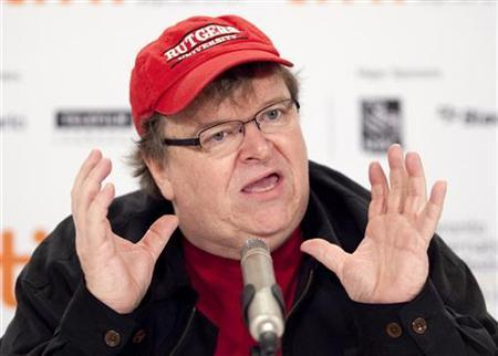 Filmmaker Michael Moore speaks about his film ''Capitalism: A Love Story'' during the 34th Toronto International Film Festival, September 14, 2009. REUTERS/Mark Blinch