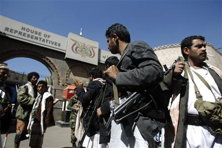 Bodyguards of Yemeni members of parliament (MPs) carry weapons outside the House of Representatives parliamentary building in Sanaa January 11, 2012. REUTERS/Khaled Abdullah