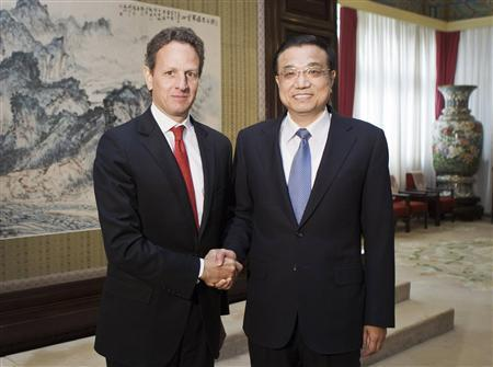 U.S. Treasury Secretary Timothy Geithner (L) shakes hands with Chinese Vice Premier Li Keqiang at the Zhongnanhai Purple Light Pavilion in Beijing January 11, 2012. REUTERS/Andy Wong/Pool