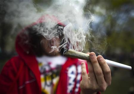 A man smokes a large joint before The Global Marijuana March in Toronto, May 7, 2011. REUTERS/Mark Blinch