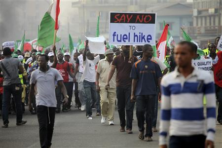 Protesters march through Ikorodu road during a protest against a fuel subsidy removal in Lagos January 9, 2012. REUTERS/Akintunde Akinleye