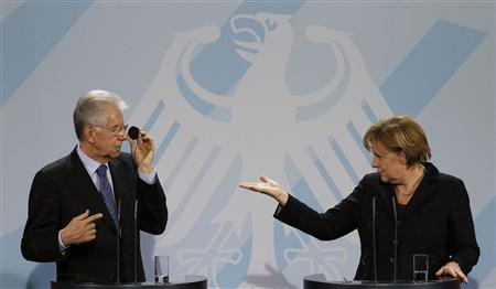 German Chancellor Angela Merkel and Italian Prime Minister Mario Monti address a news conference after talks in Berlin, January 11, 2012. REUTERS/Tobias Schwarz