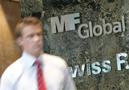 A man exits the office complex where MF Global Holdings Ltd have an office on 52nd Street in midtown Manhattan New York, October 31, 2011. REUTERS/Brendan McDermid/Files