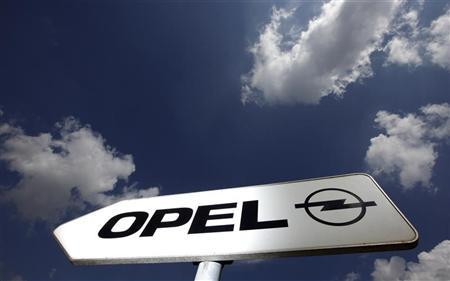 A sign indicates the way towards the headquarters of German car manufacturer Opel in Ruesselsheim, 20km from Frankfurt, June 10, 2011. REUTERS/Kai Pfaffenbach