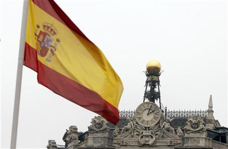 A Spanish flag flutters near the dome of the Bank of Spain in central Madrid February 15, 2010,  REUTERS/Sergio Perez