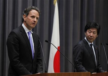 U.S. Treasury Secretary Timothy Geithner (L) speaks next to Japan's Finance Minister Jun Azumi during their joint news conference at the Finance Ministry in Tokyo January 12, 2012.   REUTERS/Toru Hanai