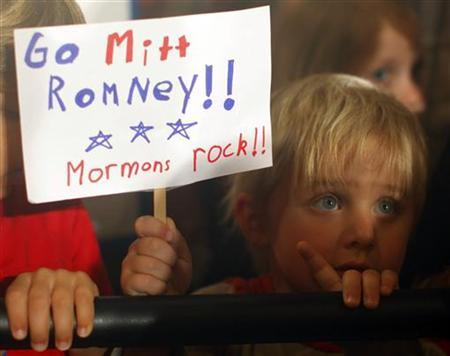 Three Year-old Dean Call holds a sign reading ''Go Mitt Romney Mormons Rock'' as Romney speaks during a campaign rally in Columbia, South Carolina, January 11, 2012.   REUTERS/Brian Snyder