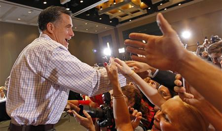 Republican presidential candidate and former Massachusetts Governor Mitt Romney greets supporters during a campaign rally in West Palm Beach, Florida, January 12, 2012.   REUTERS/Joe Skipper