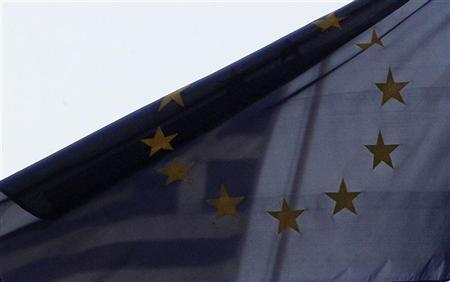 The Greek national flag and the EU flag are pictured at the Greek embassy to Germany in Berlin's Mitte district November 2, 2011. REUTERS/Tobias Schwarz